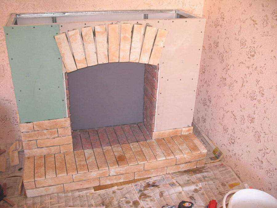 2-1-plywood-handmade-fireplace-surround-with-faux-brick-tiles-masonry-faux-fireplace-ideas