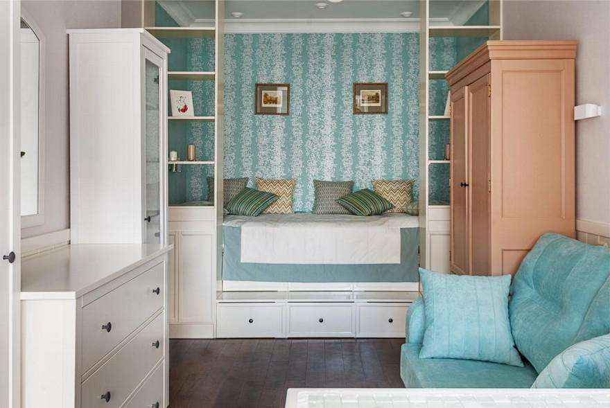 2-1-podium-bed-in-interior-design-peppermint-blue-and-white-girls-room-bedroom-white-furniture-see-through-shelves-chest-of-drawers-sofa-many-storage-areas