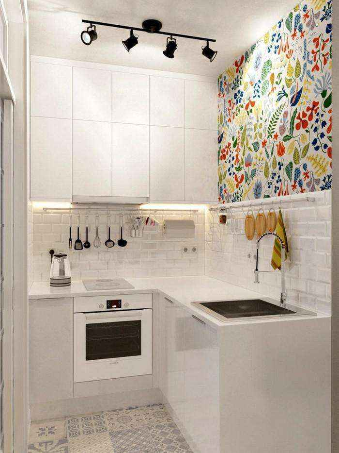 3-1-light-grayish-blue-studio-apartment-interior-design-in-modern-style-kitchen-white-top-cabinets-minimalism-floral-wall-tiles-l-shaped-set-beige-floor-tiles-white-backsplash