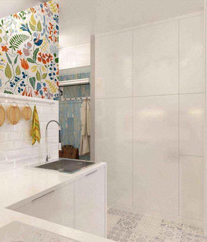 4-light-grayish-blue-studio-apartment-interior-design-in-modern-style-l-shaped-small-kitchen-set-white-cabinets-built-in-closet-floral-wall-tiles-backsplash