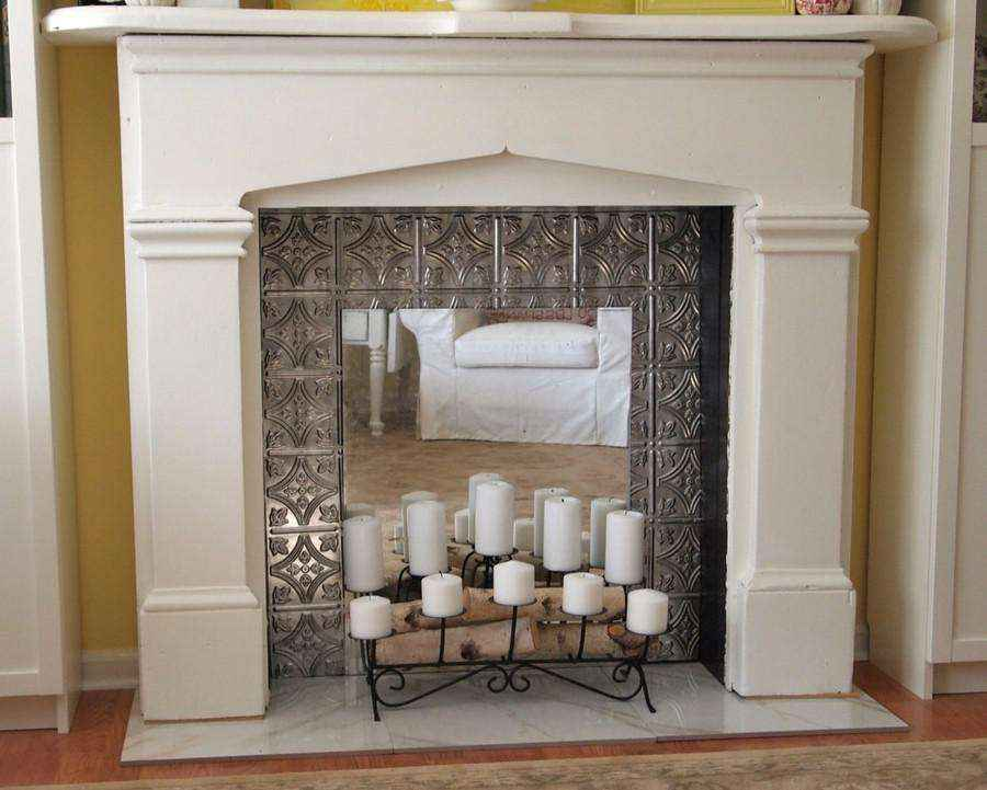 5-1-white-plasterboard-surround-mirrored-interior-with-candles-romantic-ideas-metal-wrought-candlestick-faux-fireplace-ideas